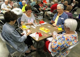 The Sentinel-Record/Richard Rasmussen DEAL THE CARDS: Joyce Franklin, left, of Little Rock, Shirley Haydel, of McComb, Miss., Art Pheifer, of Little Rock, and Dixie Miller, of Bogue Chitto, Miss., play bridge during the Resort City Regional bridge tournament Tuesday at Hot Springs Convention Center.