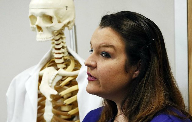 kathryn-winfield-stands-next-to-the-medical-skeleton-she-worked-on-at-meridian-community-college-in-mississippi-she-now-works-at-a-nursing-home-earning-more-than-13-an-hour