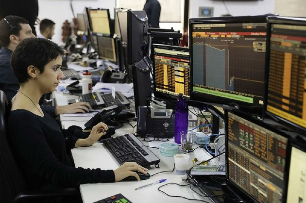 a-worker-monitors-screens-at-a-sao-paulo-brokerage-as-brazils-markets-and-currency-reacted-thursday-to-the-latest-scandal-surrounding-the-countrys-president