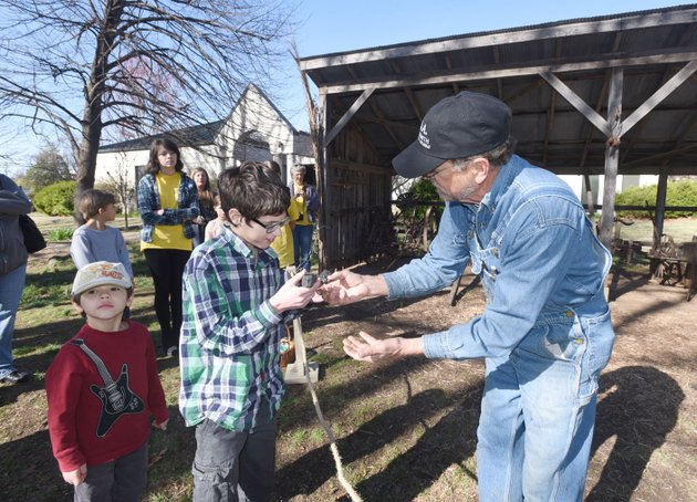 owen-whitaker-looks-at-chunks-of-coal-with-blacksmith-joe-doster-of-huntsville-during-a-demonstration-at-the-shiloh-museum-of-ozark-history-summer-history-camps-start-june-19-at-the-springdale-museum