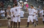 Texas A&M's Hunter Coleman (10) taps helmets with teammates Nick Choruby (18) and Braden Shewmake (8) after hitting a three-run home run during an NCAA college baseball game against Arkansas, Friday, May 19, 2017, in College Station, Texas. (Timothy Hurst/College Station Eagle via AP)