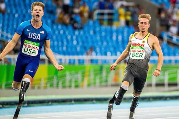 Johannes Floores (R) of Germany and Hunter Woodhall (L) of USA react after the Final Men's 4x100m Relay during the Rio 2016 Paralympic Games in Rio de Janeiro, Brazil, on Monday, Sept. 12, 2016. (Jens Büttner/AP Images)