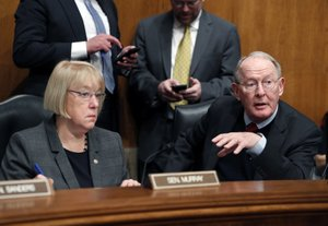 In this Jan. 31, 2017 file photo, Senate Health, Education, Labor, and Pensions Committee Chairman Sen. Lamar Alexander, R-Tenn., accompanied by the committee's ranking member Sen. Patty Murray, D-Wash. speaks on Capitol Hill in Washington.