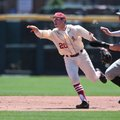 Arkansas' Carson Shaddy makes a quick toss to Jax Biggers (not pictured) to catch Vanderbilt's Will ...