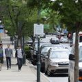 Pedestrians walk at midday Tuesday along Dickson Street in Fayetteville. Dickson Street Merchants As...