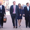 Former state Sen. Jon Woods (right) walks with his attorney Patrick Benca (far left) and others fr...