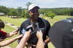 Former Arkansas basketball player Sidney Moncrief speaks with members of the media during Mike Anderson's celebrity golf tournament Monday, May 22, 2017, at Shadow Valley Country Club in Rogers.