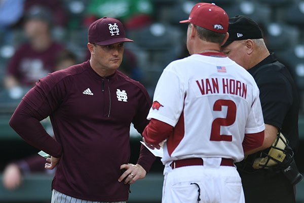 Mississippi State coach Andy Cannizaro talks with Arkansas coach Dave Van Horn prior to a game Friday, March 17, 2017, in Fayetteville.