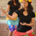 "Lillian Chonggum of Springdale dances a traditional Marshallese dance during the ""Welcoming NWA: Cel..."