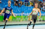Johannes Floores (right) of Germany and Hunter Woodhall (left) of USA react after the Final Men's 4x100m Relay during the Rio 2016 Paralympic Games in Rio de Janeiro, Brazil, on Monday, Sept. 12, 2016. (Jens Büttner/AP Images)
