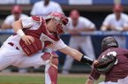 Arkansas catcher Grant Koch tries to tag out Ryan Gridley of Mississippi State as he slides in to score in the top of the ninth inning Thursday, May 25, 2017, during a game at the SEC Tournament at Hoover Metropolitan Stadium in Hoover, Ala. The run tied the game at 3-3.