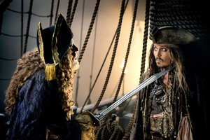 Captain Hector Barbossa (Geoffrey Rush) makes a point while debating Captain Jack Sparrow in Disney's The Pirates of the Caribbean: Dead Men Tell No Tales.