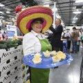Ginger Edwards of Tulsa, Okla., gives out samples of guacamole Thursday at the opening of the Spring...