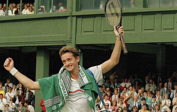 Australia's Peter Doohan raises his arms in victory after defeating defending champion Boris Becker on the Number One Court at Wimbledon, June 26, 1987. Doohan scored a 7-6, 4-6, 6-2, 6-4 victory to eliminate Becker in the second round of the tournament. (AP Photo/John Redman)