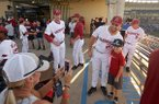 Chad Spanberger, Arkansas first baseman, takes pictures with fans Friday, May, 26, 2017, before a game against Mississippi State at the SEC Tournament in Hoover, Ala.