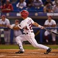 Arkansas center fielder Dominic Fletcher hits a home run to lead off the sixth inning against Missis...