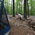 Taylor Walts of Centerton stakes down his tent Friday at the Prairie Creek Recreation Area and Campg...
