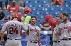 Arkansas first baseman Chad Spanberger (24) is greeted by teammates after a home run during the first inning of an SEC Tournament game against Florida on Saturday, May 27, 2017, in Hoover, Ala.