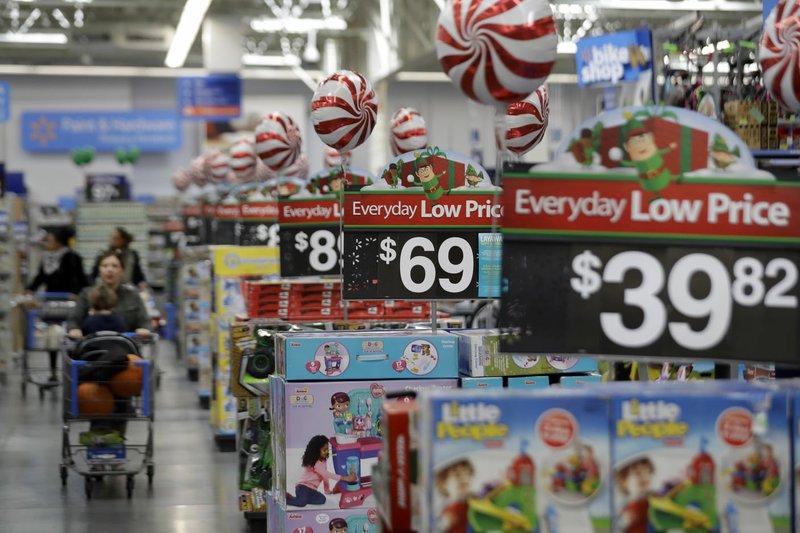 Wal-Mart details execs' pay, awards