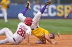 Arkansas outfielder Dominic Fletcher (28) slides into LSU second baseman Cole Freeman during an SEC Tournament game on Sunday, May 28, 2017, in Hoover, Ala.