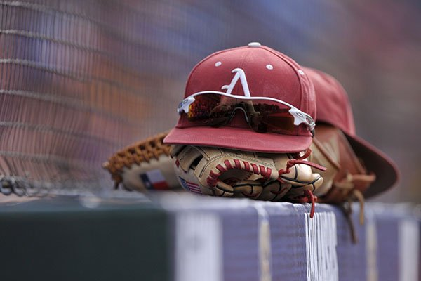 An Arkansas baseball hat sits atop a glove in the dugout prior to an SEC Tournament game against LSU on Sunday, May 28, 2017, in Hoover, Ala.