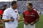 Mississippi head coach Hugh Freeze, left, and Alabama head coach Nick Saban confer prior to their NCAA college football game, Saturday, Sept. 17, 2016 in Oxford, Miss. (AP Photo/Rogelio V. Solis)