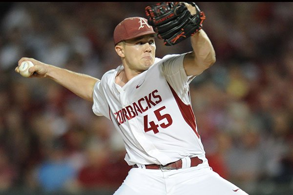 Arkansas pitcher Kevin Kopps throws during an NCAA Tournament game against Oral Roberts on Friday, June, 2, 2017, in Fayetteville.