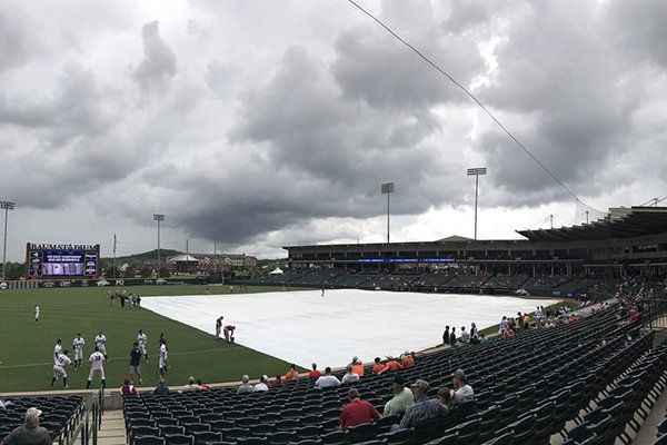 A tarp covers the field at Baum Stadium during a rain delay prior to a game between Oklahoma State and Oral Roberts on Saturday, June 3, 2017, in Fayetteville.