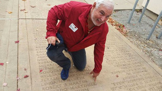ricardo-martinelli-who-served-as-president-of-panama-for-five-years-kneels-at-the-spot-on-the-university-of-arkansas-fayetteville-campus-senior-walk-that-bears-his-name-as-a-graduate-in-this-undated-photo