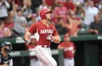 Arkansas' Chad Spanberger watches his 20th home run of the season clear the fence in the seventh inning against Oral Roberts Saturday June 4, 2017 during the NCAA Fayetteville Regional at Baum Stadium. Arkansas won 4-3.
