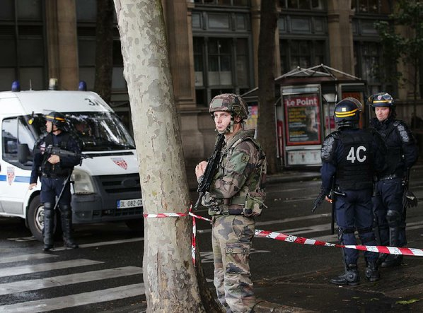 Paris police: Attacker shot near Notre Dame