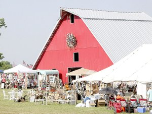 LYNN KUTTER ENTERPRISE-LEADER The big, red barn is the main feature of the Junk Ranch vintage fair, which gets underway Friday and Saturday in Prairie Grove. In addition, three other vintage fairs, also featuring food, music and other activities, will be going on in the communty. Lots to do and lots happening in Prairie Grove this weekend.