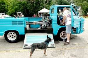 PHOTOS BY LYNN KUTTER ENTERPRISE-LEADER Cyclone Cox, of Greenland, brought his dog Blu, a minature blue heeler, and his 1962 Corvair 95 Rampside to the Cardinal Car Classic on Saturday. The vehicle gets its name from the side ramp.