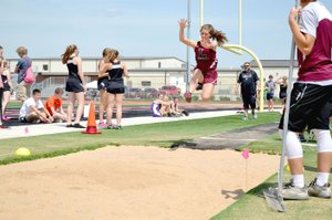 Annette Beard Special to the Enterprise-Leader/Lincoln junior Madison Jones takes off during long jump competition during the 4A-1 Conference track and field meet hosted by Pea Ridge April 25. Jones placed third for Lincoln with a mark of 14-8.5.