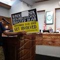 Resident Alan Ostner holds a sign depicting the 2007 campaign to develop a Walker Park neighborhood...