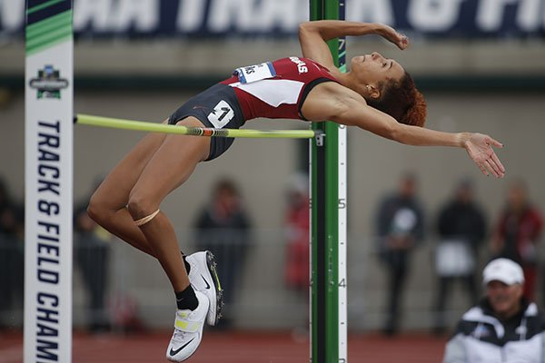In this file photo Arkansas' Taliyah Brooks attempts to clear the bar in the heptathlon high jump on the third day of the NCAA outdoor college track and field championships in Eugene, Ore., Friday, June 9, 2017.
