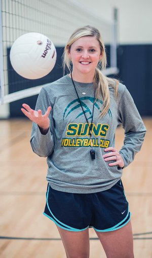 Kaci Posey tosses a volleyball in the Dover Middle School gymnasium as she prepares for the first day of practice as coach of the new girls volleyball team. Posey is a former volleyball player for the Arkansas Tech University Golden Suns in Russellville.