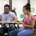Mia Preston, 14, of Fort Worth, Texas, fills out a questionnaire Friday alongside her uncle Sheldon ...