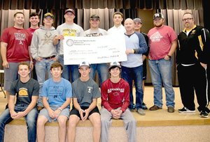 Submitted photo The 2017 Prairie Grove baseball team presented a check in the amount of $4,000 to PGHS assistant principal Joey Sorters May 30. The check represented funds raised during the first annual Jarren Sorters Memorial Baseball Tournament hosted by Prairie Grove during spring break. The entire team wore No. 27, Jarren Sorters' number on the back of their baseball caps throughout the season. Jarren Sorters was the son of Joey and Donna Sorters, of Prairie Grove. He passed Aug. 11, 2016, after battling childhood cancer .