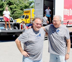 Keith Bryant/The Weekly Vista Volunteer Ken Lassiter, left, has a laugh with volunteer Norm Hanson, a Wisconsin resident who has come to Bella Vista to volunteer with the Cancer Challenge the past 18 years.