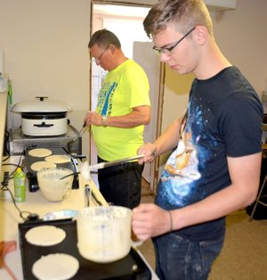 Janelle Jessen/Herald-Leader Samuel Hassett cooked pancakes on the griddle inside the Word of Life Fellowship during the New Beginnings Pregnancy Services fundraiser on Saturday morning. The event included a 5K race, 1 mile walk and 20 mile cycle, as well as a pancake breakfast.