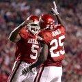 Arkansas running backs Darren McFadden (5) and Felix Jones (25) celebrate during a game against Sout...