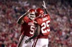 Arkansas running backs Darren McFadden (5) and Felix Jones (25) celebrate during a game against South Carolina on Saturday, Nov. 3, 2007, in Fayetteville.