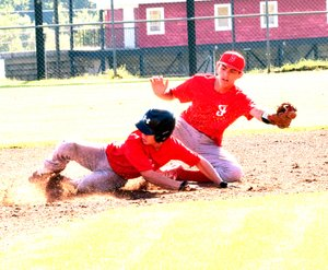Photo by Rick Peck McDonald County's Sampson Boles gets tagged out while attempting to steal second base during McDonald County's 12-2 loss on June 6 at McDonald County High School.
