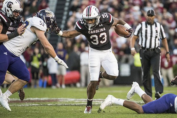 South Carolina running back David Williams (33) runs the ball against Western Carolina linebacker Daniel Riddle (58) during the first half of an NCAA college football game Saturday, Nov. 19, 2016, in Columbia, S.C. (AP Photo/Sean Rayford)