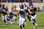 ULM quarterback Kolton Browning runs for the game-winning touchdown during overtime of a game against Arkansas on Saturday, Sept. 8, 2012, in Little Rock.