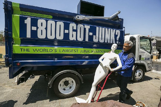 james-williams-owner-of-a-1-800-got-junk-franchise-in-burbank-calif-says-he-gains-work-cleaning-out-closed-stores-but-he-also-loses-a-regular-customer-at-the-same-time