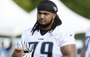 Tennessee Titans offensive guard Sebastian Tretola leaves the field after NFL football training camp Sunday, July 31, 2016, in Nashville, Tenn. (AP Photo/Mark Zaleski)
