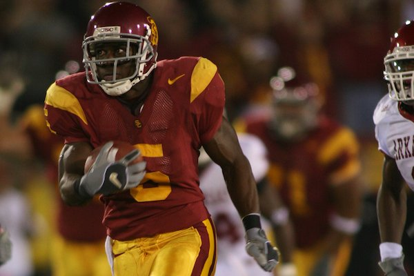 Reggie Bush scores in the first quarter of USC's 70-17 win over Arkansas on Sept. 17, 2005, at Los Angeles Memorial Coliseum in Los Angeles, Calif.
