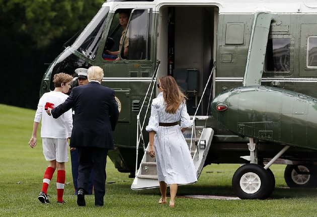 president-donald-trump-boards-marine-one-with-his-son-barron-and-wife-melania-on-the-white-house-lawn-saturday-on-his-way-to-his-first-visit-to-the-presidential-retreat-at-camp-david
